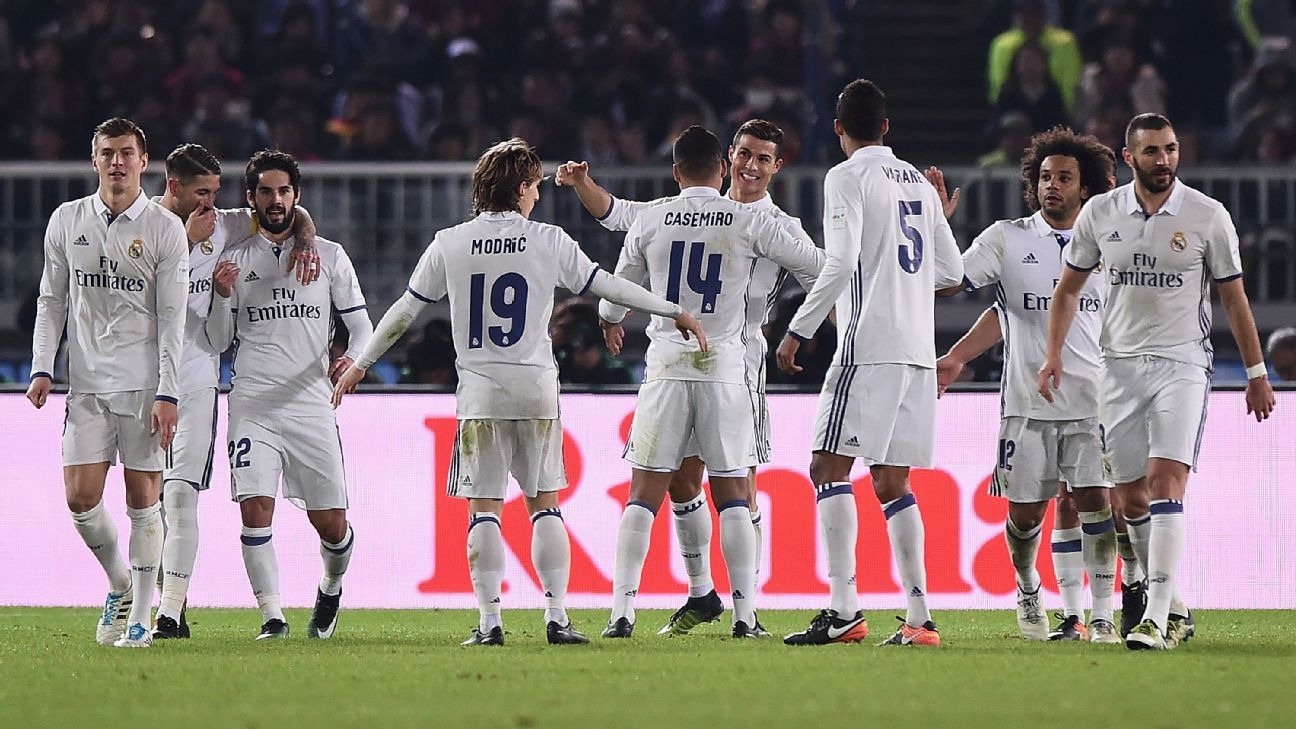 Cristiano Ronaldo is congratulated by teammates after scoring for Real Madrid in the Club World Cup final against Kashima Antlers.