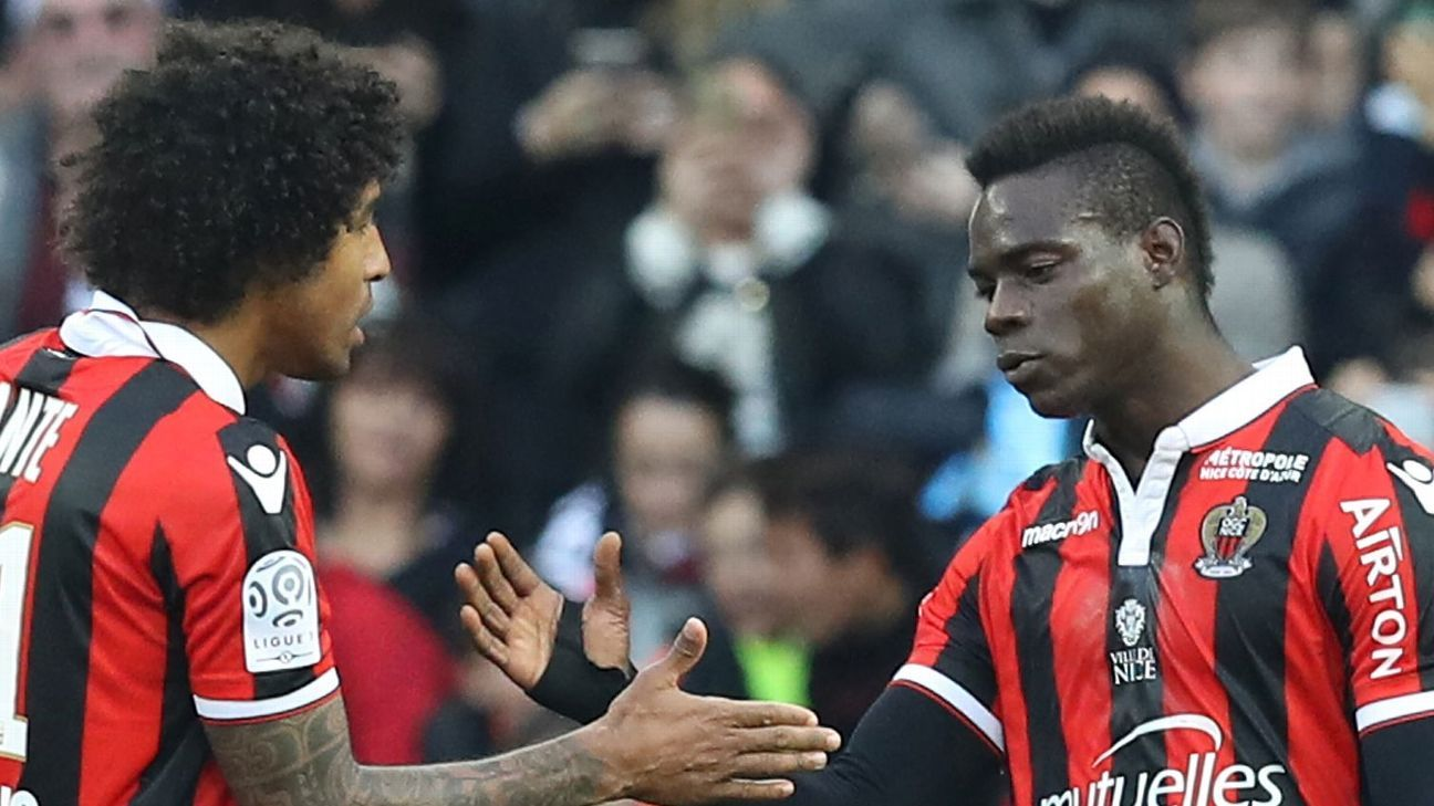 Mario Balotelli is congratulated by Nice teammate Dante after scoring for Nice against Dijon in Ligue 1.