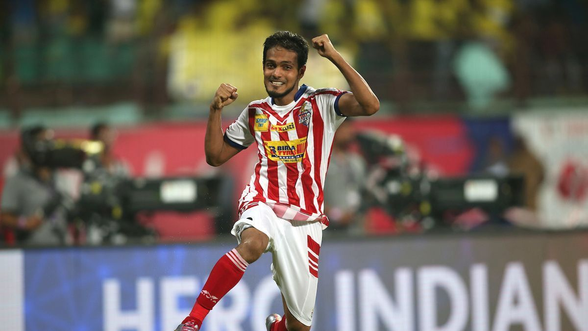 Jewel Raja celebrates scoring the winning penalty for ATK.
