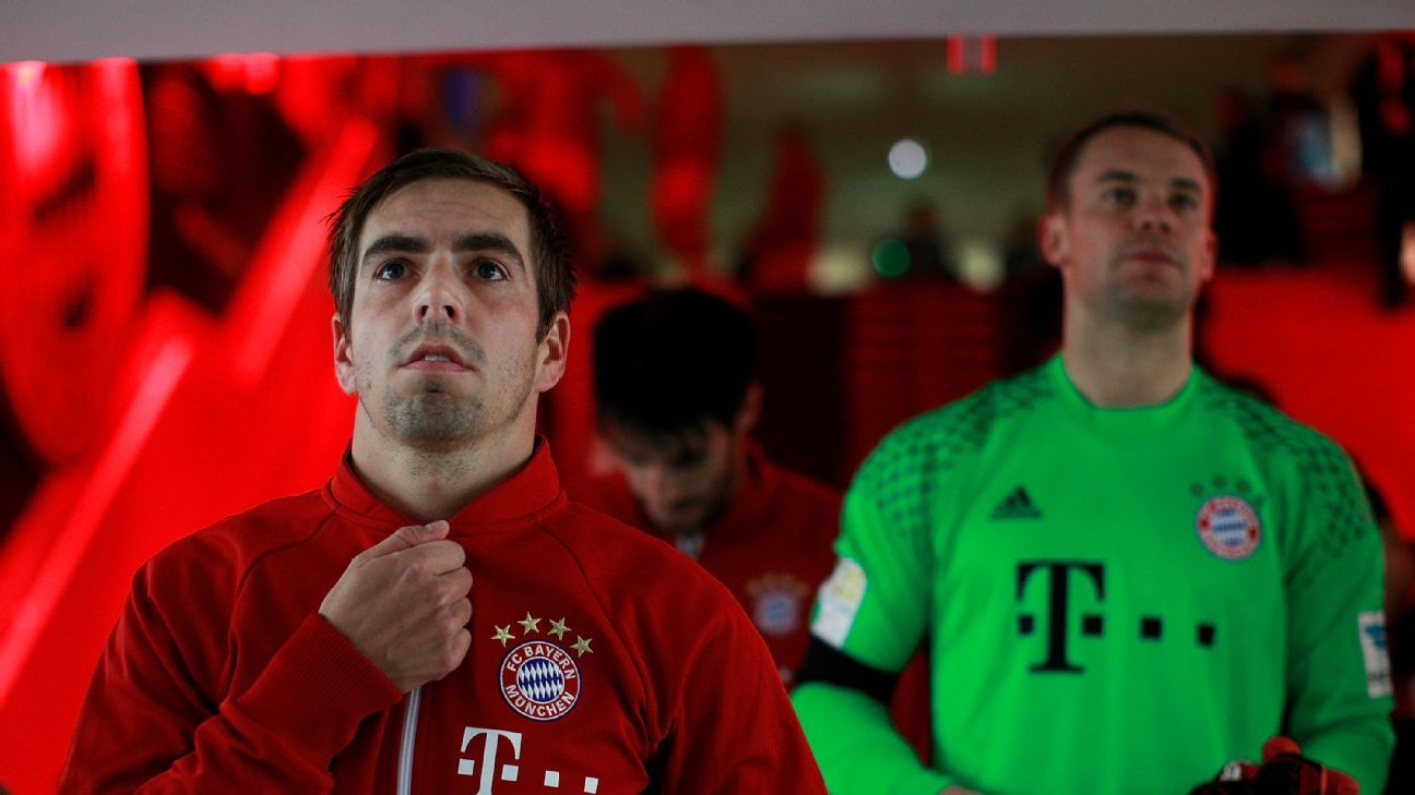 Philipp Lahm and Manuel Neuer of Bayern Munich prepare for the Bundesliga game against Bayer Leverkusen.