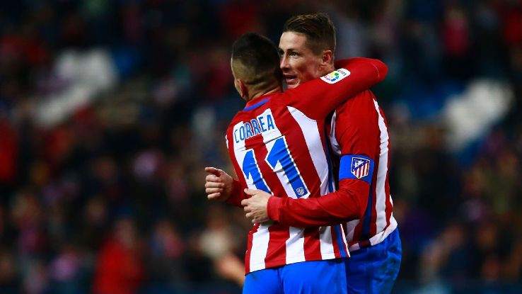 Fernando Torres celebrates with Angel Correa after scoring a goal against Guijuelo in the Copa del Rey.