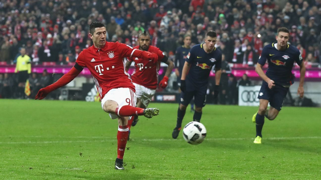 Robert Lewandowski scores for Bayern Munich from the penalty spot against RB Leipzig.