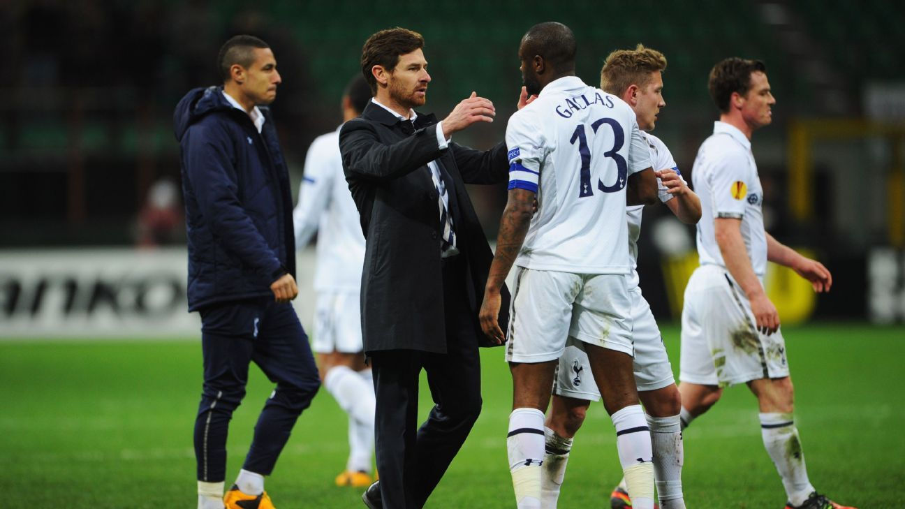 Andre Villas-Boas embraces William Gallas following Tottenham Hotspur's Europa League game against Inter Milan.