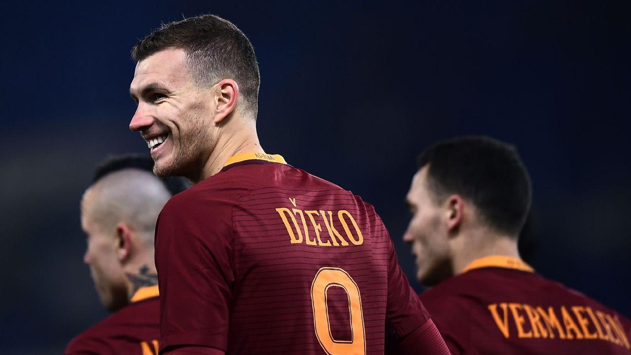 Edin Dzeko celebrates after scoring Roma's second goal versus Chievo Verona.