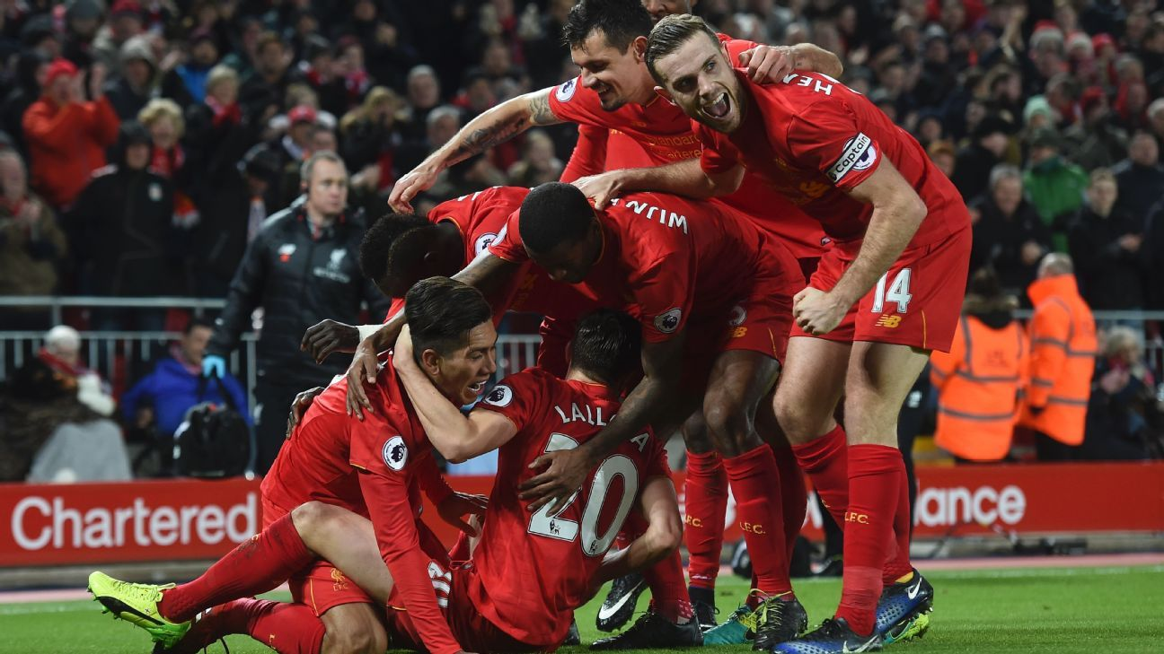 Liverpool celebrate after Roberto Firmino's first-half goal.