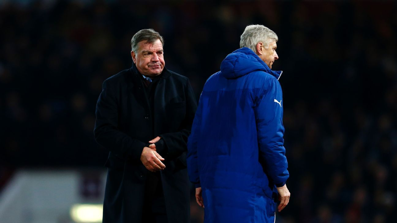 LONDON, ENGLAND - DECEMBER 28:  Arsene Wenger, manager of Arsenal walks past Sam Allardyce the West Ham manager during the Barclays Premier League match between West Ham United and Arsenal at Boleyn Ground on December 28, 2014 in London, England.