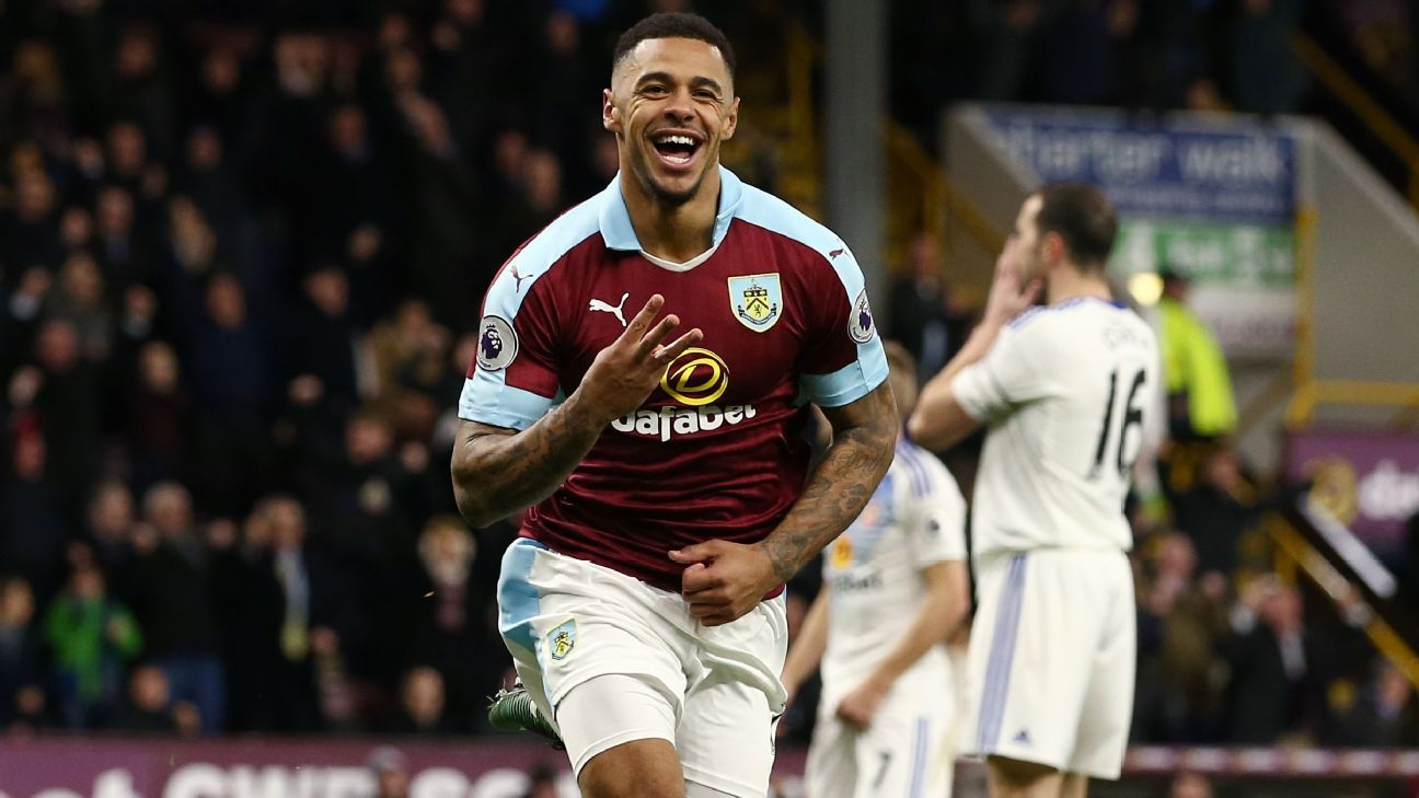 Andre Gray celebrates scoring his hat trick.