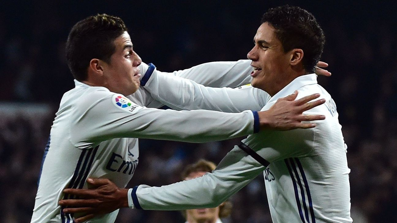 Raphael Varane, right, and James Rodriguez celebrate after the French defender scored his team's second goal against Sevilla.
