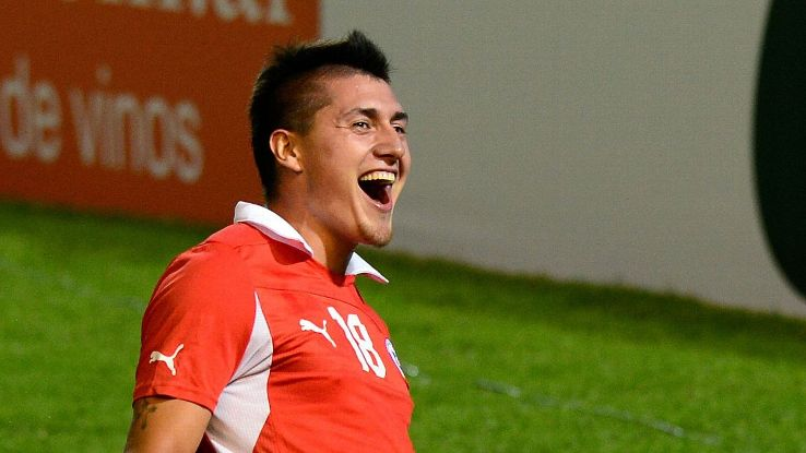 Chile's forward Nicolas Castillo celebrates after he scores a goal to Bolivia during their football match at Malvinas Argentinas stadium in Mendoza, Argentina, on January 11, 2013 for the qualifying stage of the Group A South American U-20 football tourna