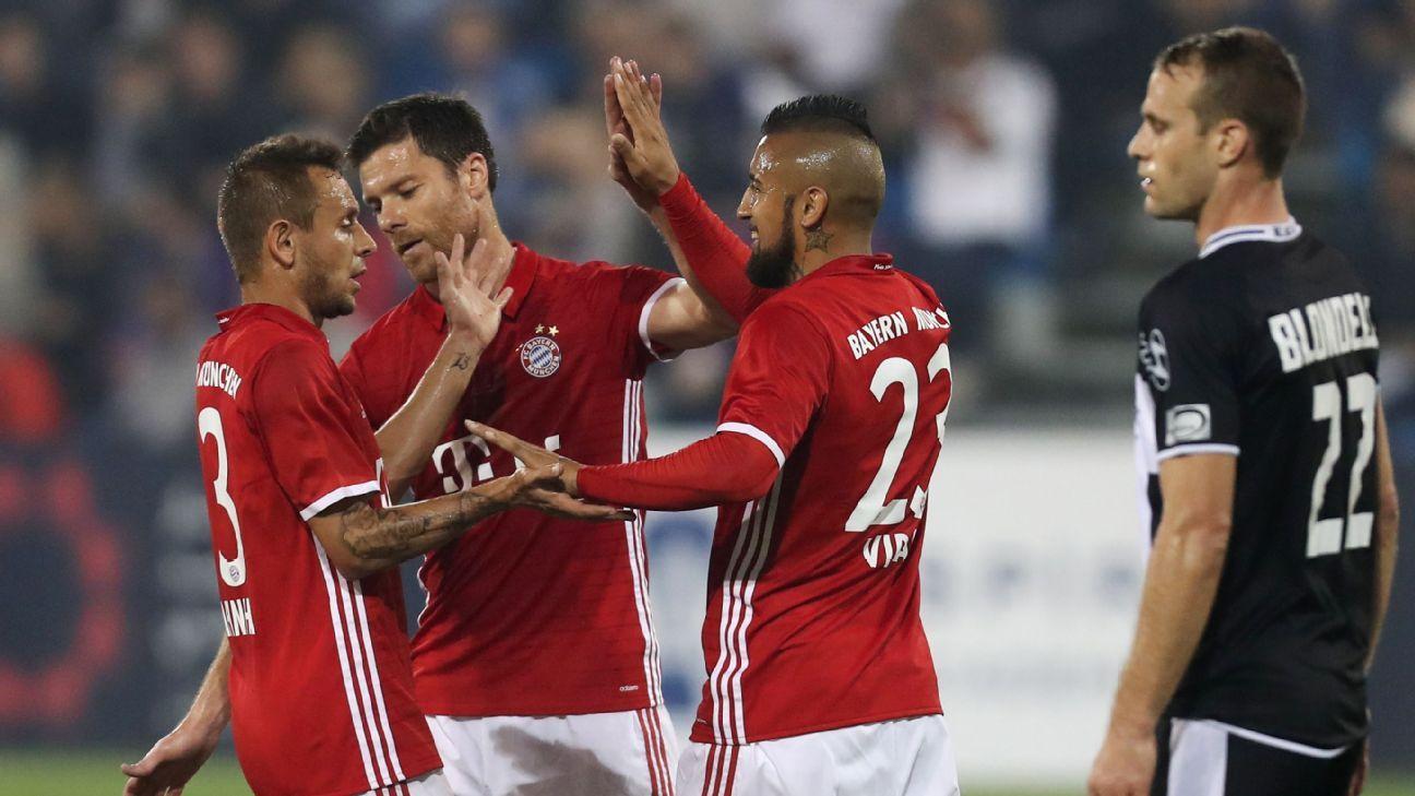 Bayern Munich's players celebrate after scoring against Belgium's KAS Eupen during a friendly football match.