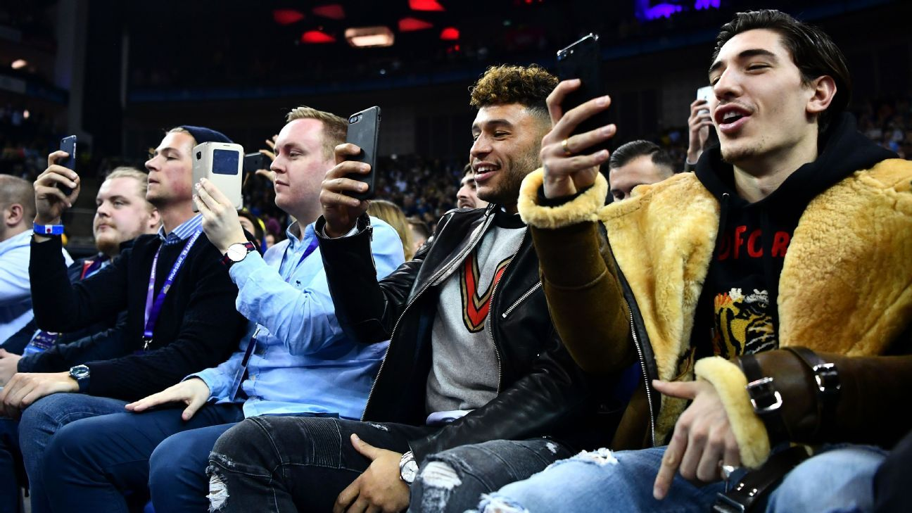 Arsenal players at the NBA game