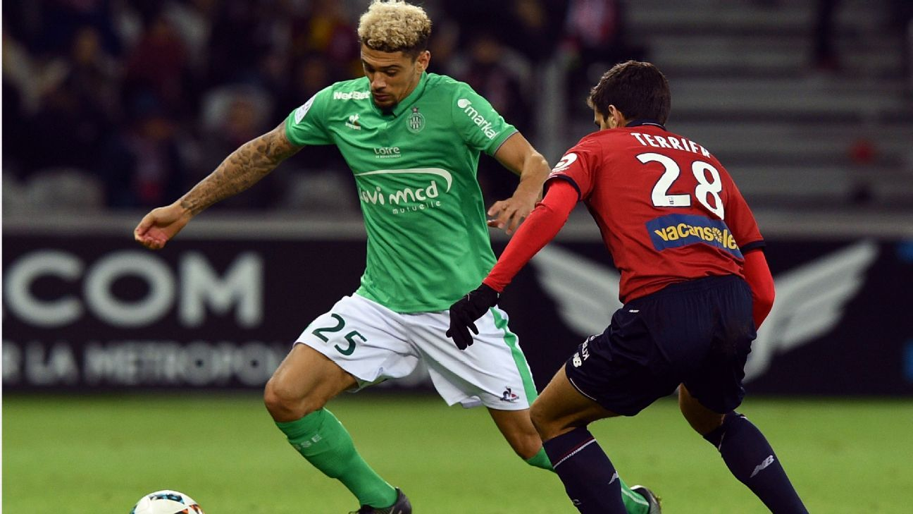 Lille's Martin Terrier and Kevin Malcuit of St Etienne battle during the teams' 1-1 draw in Ligue 1 on Friday.