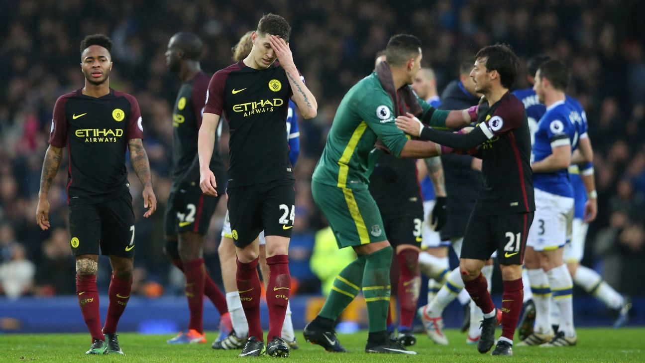 John Stones leaves the pitch after Manchester City's heavy loss to Everton.
