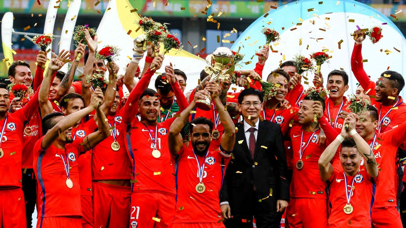 Players of Chile celebrate after winning 2017 Gree China Cup International Football Championship final match against Iceland at Guangxi Sports Center Stadium in Nanning, south China's Guangxi province on January 15, 2017.