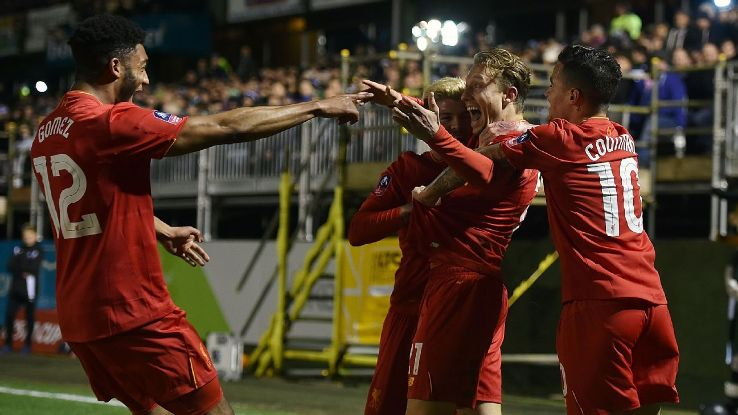 Lucas Leiva celebrates after scoring the opener for Liverpool against Plymouth Argyle in the FA Cup.