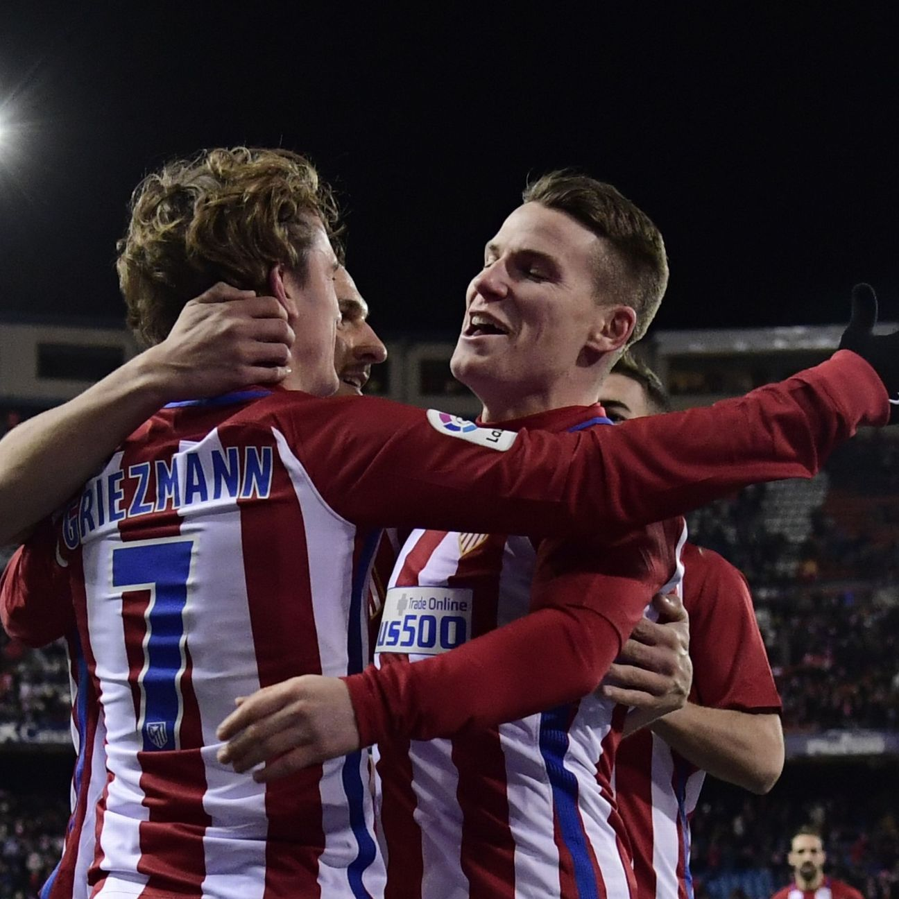 Antoine Griezmann, left, and Kevin Gameiro celebrate Atletico's win.