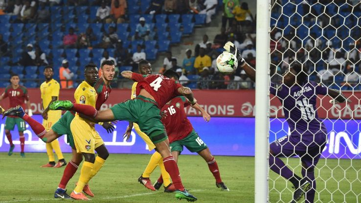 Morocco's Romain Saiss beats Togo's goalkeeper Kossi Agassa in their African Nations Cup match on Friday.