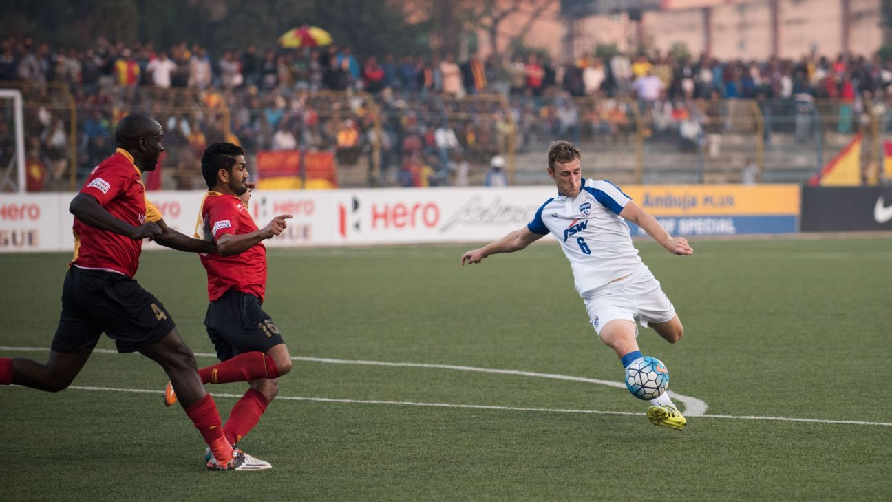 Bengaluru FC defender John Johnson takes a shot against East Bengal at the Barasat Stadium, in Kolkata, on Sunday.