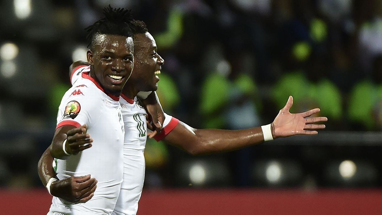 Burkina Faso's midfielder Alain Traore and Bertrand Traore celebrate after a goal in a 2-0 win against Guinea-Bissau.