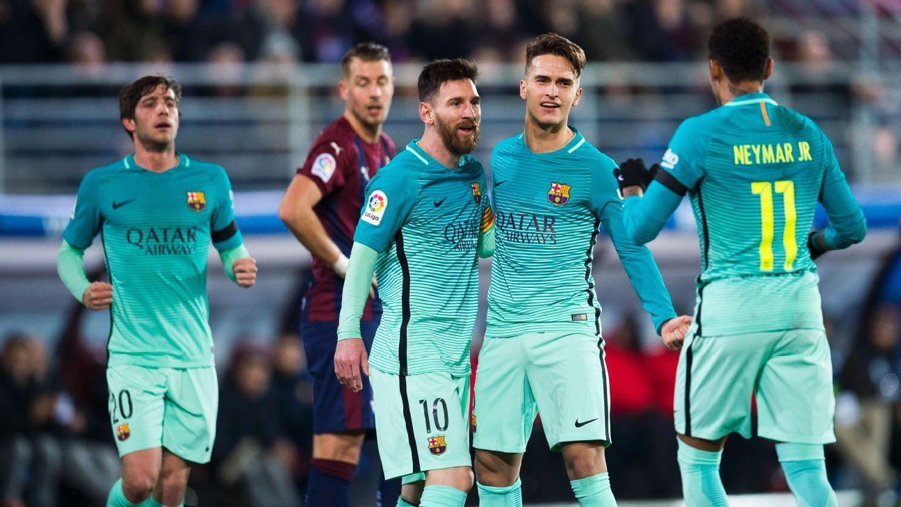 Lionel Messi and his Barcelona teammates celebrate after opening the scoring against Eibar on Sunday.