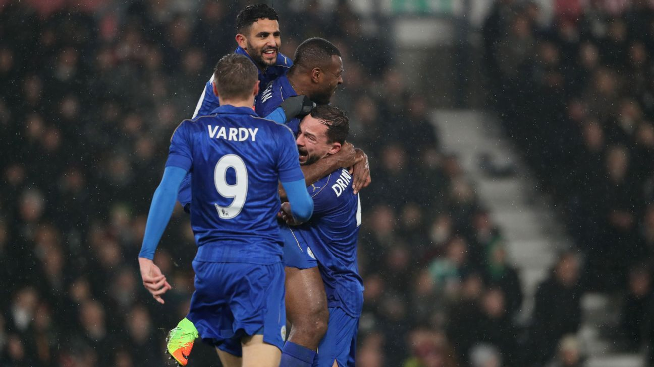 Leicester players celebrate after Wes Morgan scored the equaliser in a 2-2 draw with Derby County.