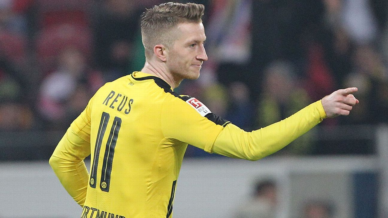 Marco Reus celebrates after opening the scoring for Borussia Dortmund in a 1-1 draw against Mainz.