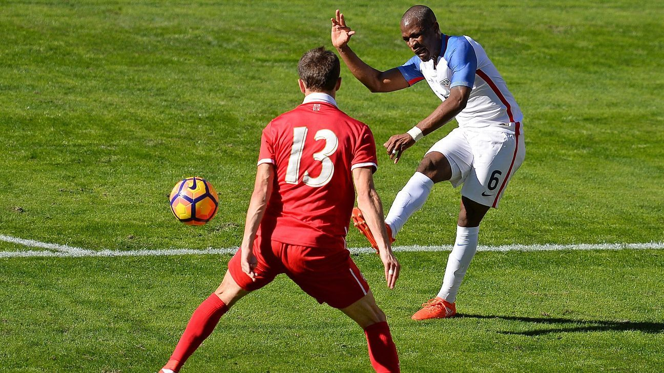 Darlington Nagbe curls a shot around a Serbian defender in a friendly on Sunday in San Diego.