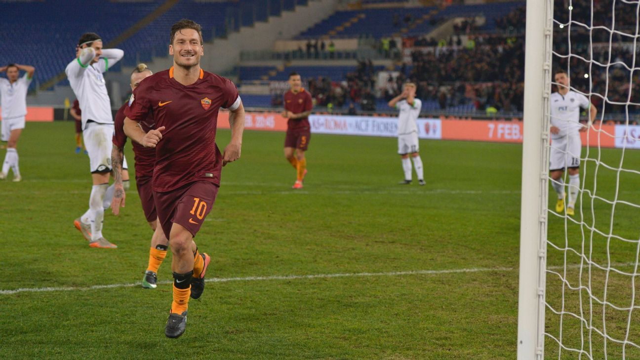 Francesco Totti celebrates after scoring the winner against Cesena in the Coppa Italia.