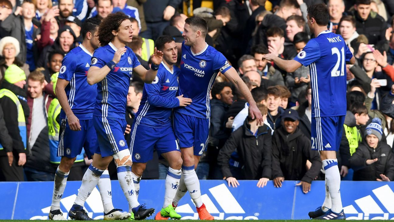 Chelsea celebrate after Eden Hazard doubles their lead against Arsenal.