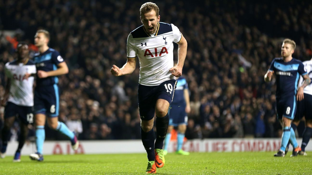 Harry Kane celebrates after scoring the match-winning penalty.