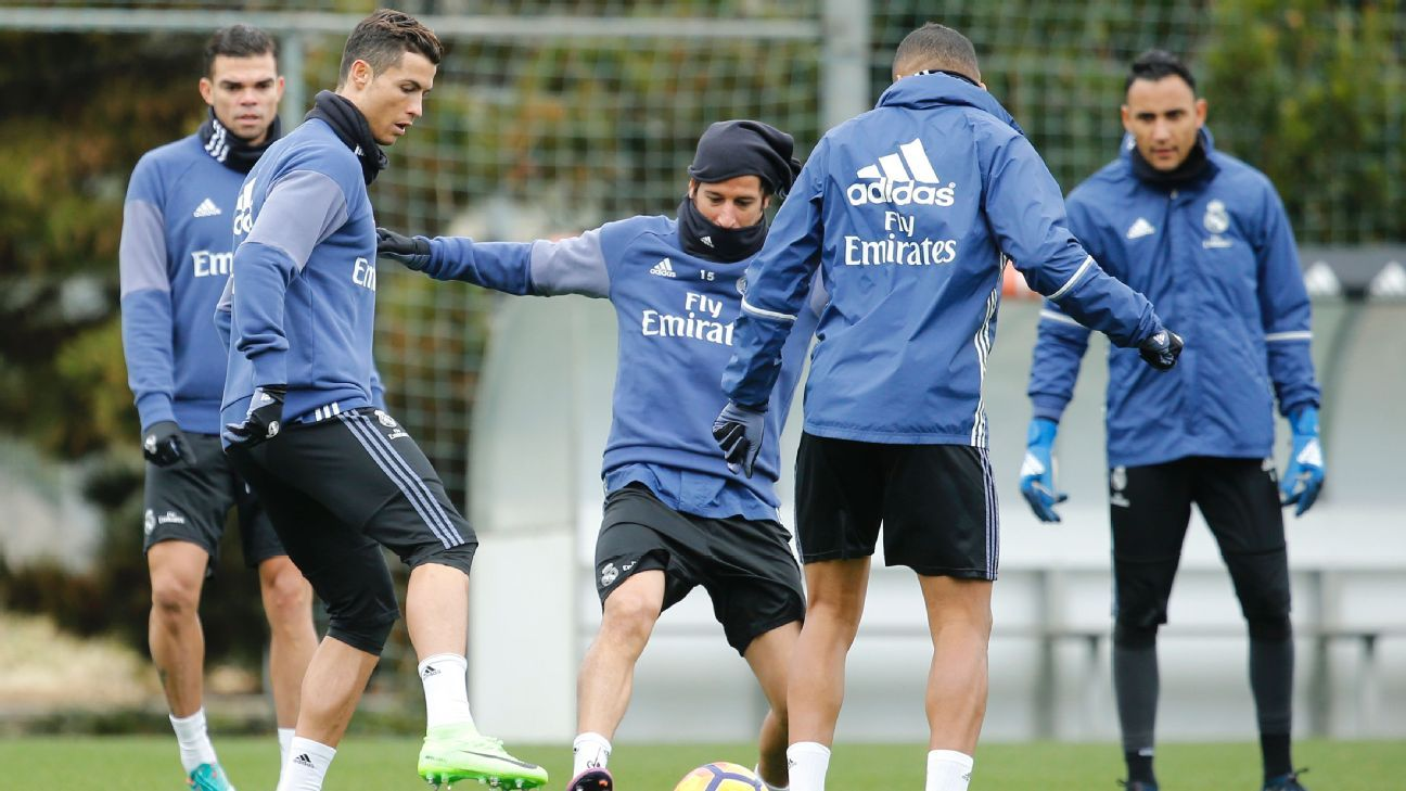 Cristiano Ronaldo and Fabio Coentrao of Real Madrid warm up during a training session at Valdebebas training ground.