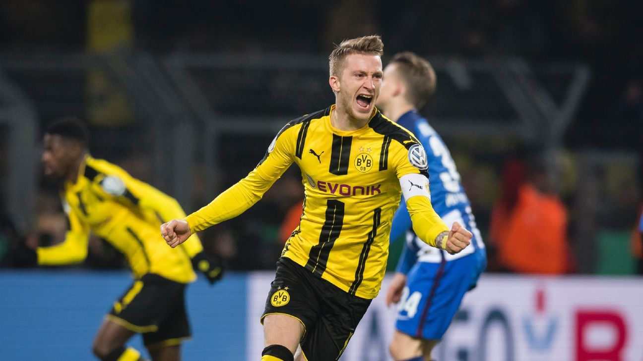 Marco Reus celebrates after scoring a goal for Borussia Dortmund vs. Hertha Berlin in the DFB Pokal Cup.