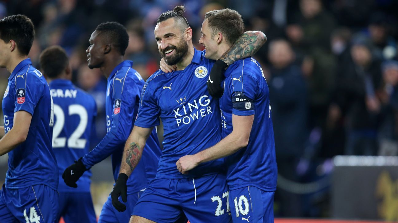 Andy King celebrates with his Leicester City teammates after scoring a goal against Derby County in the FA Cup.