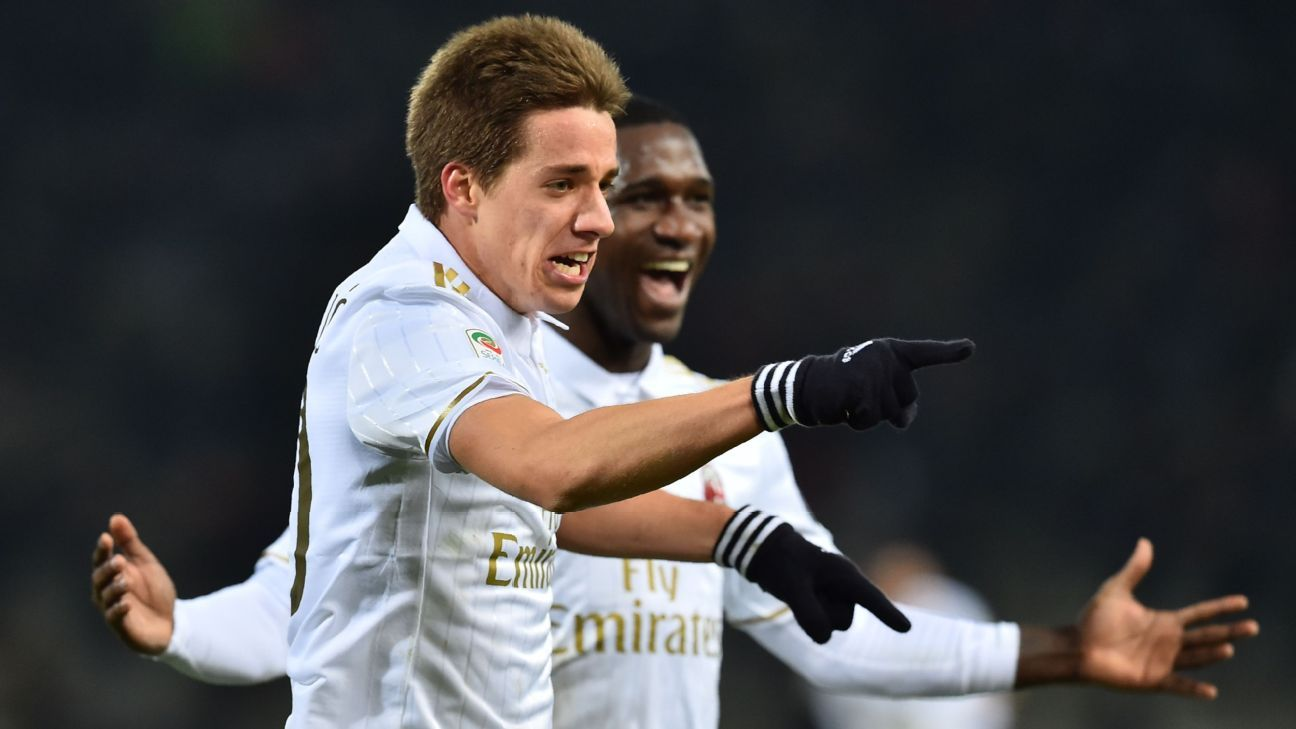 AC Milan midfielder Mario Pasalic celebrates after scoring the winner against Bologna.