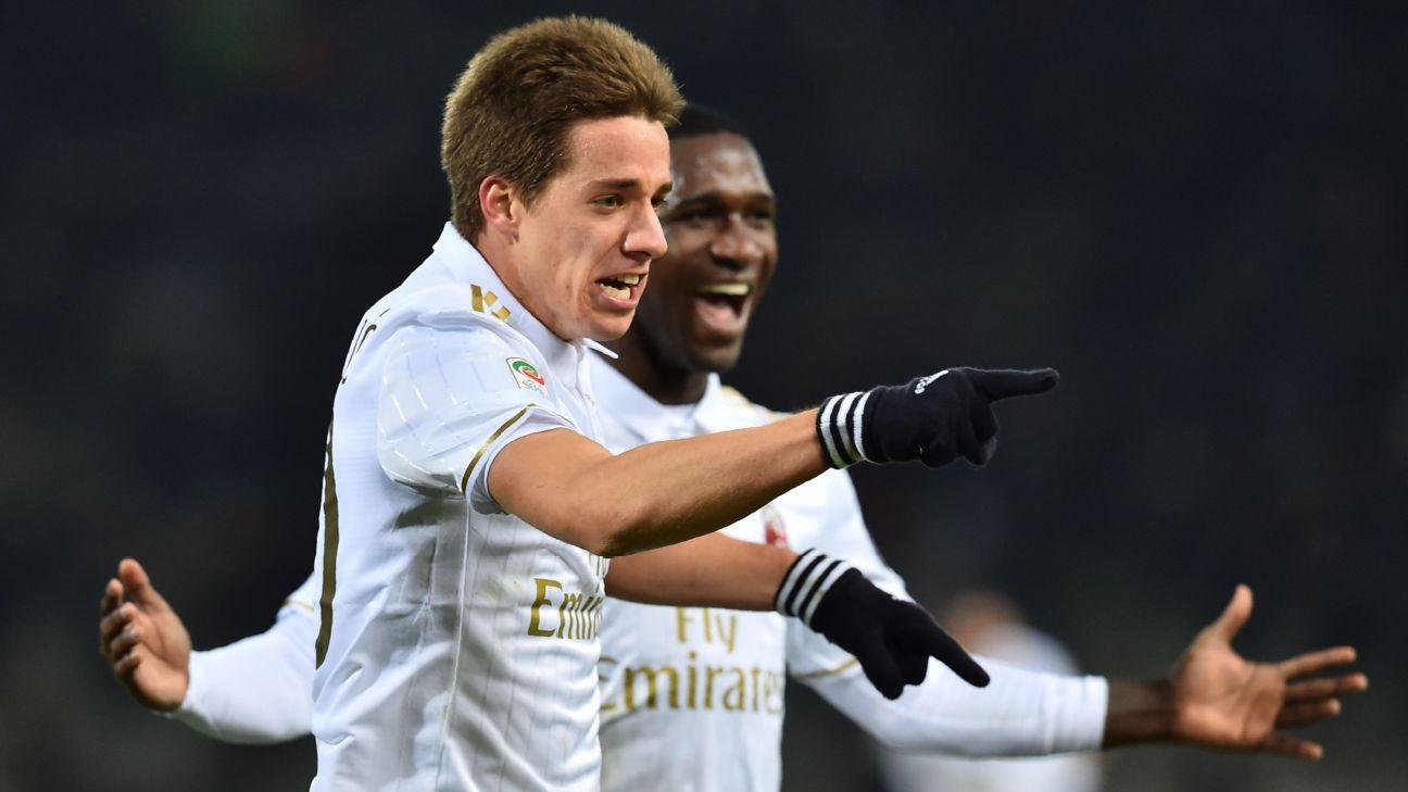 AC Milan midfielder Mario Pasalic celebrates after scoring the winner against Bologna.