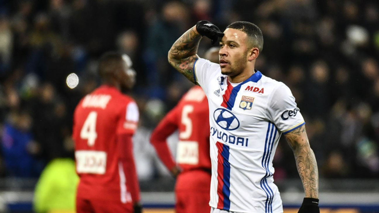 Memphis Depay celebrates after scoring a goal for Lyon against Nancy.