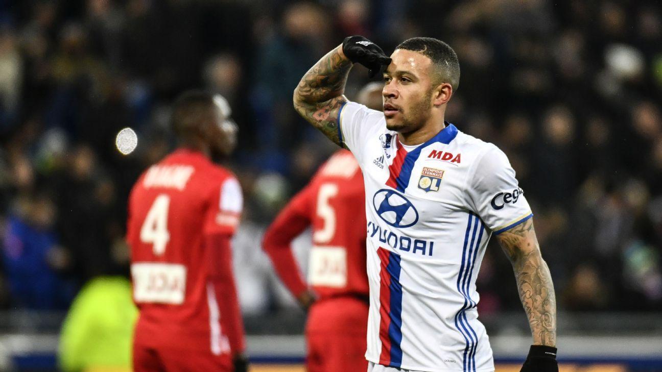 Memphis Depay celebrates after scoring a goal for Lyon against Nancy.