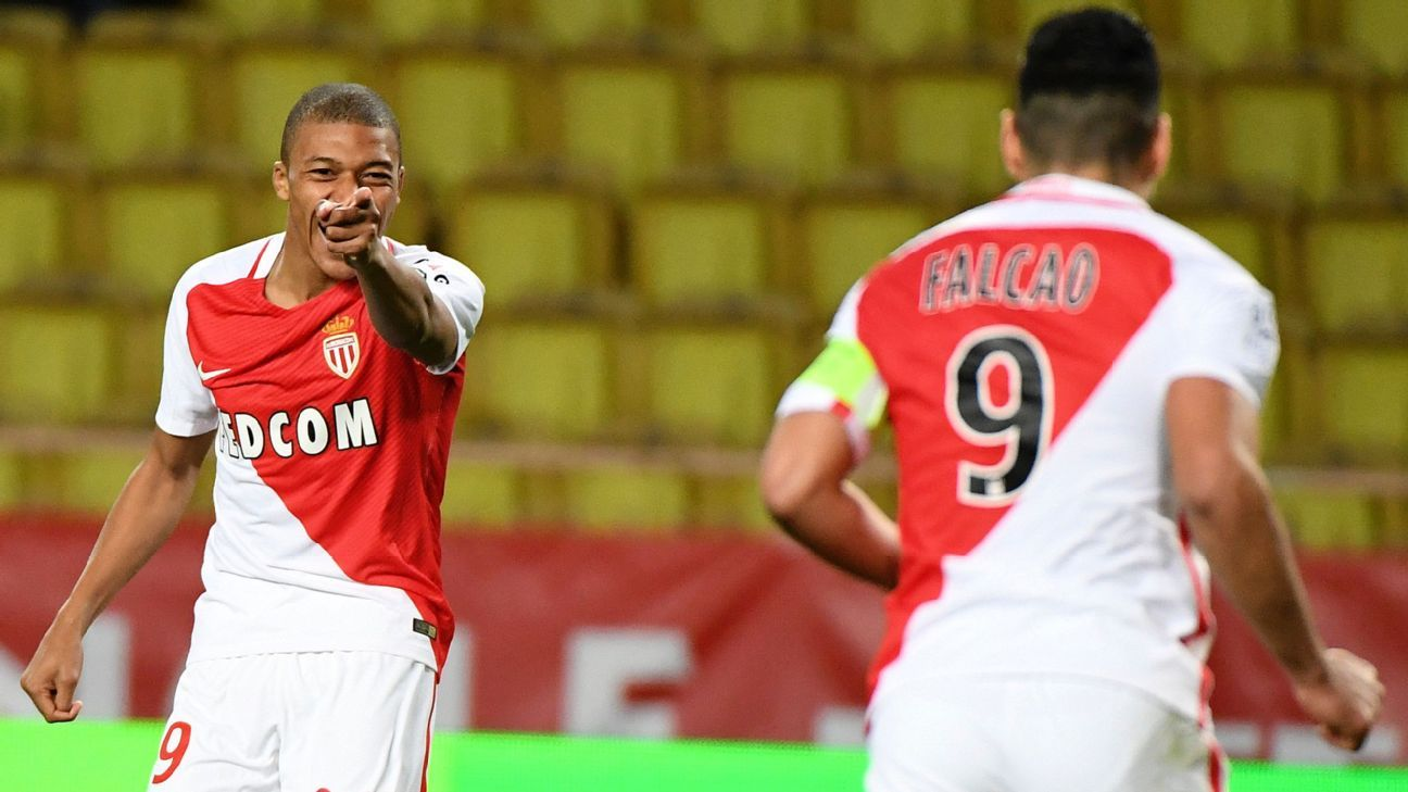 Kylian Mbappe of Monaco celebrates with Radamel Falcao after scoring in a win against Metz on Saturday.