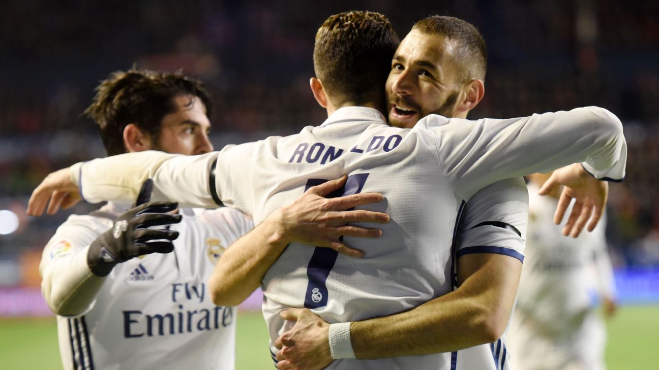 Cristiano Ronaldo celebrates with Karim Benzema after opening the scoring.