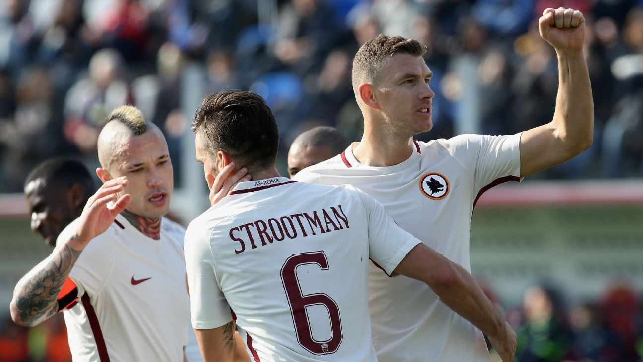 Edin Dzeko celebrates after scoring Roma's second.
