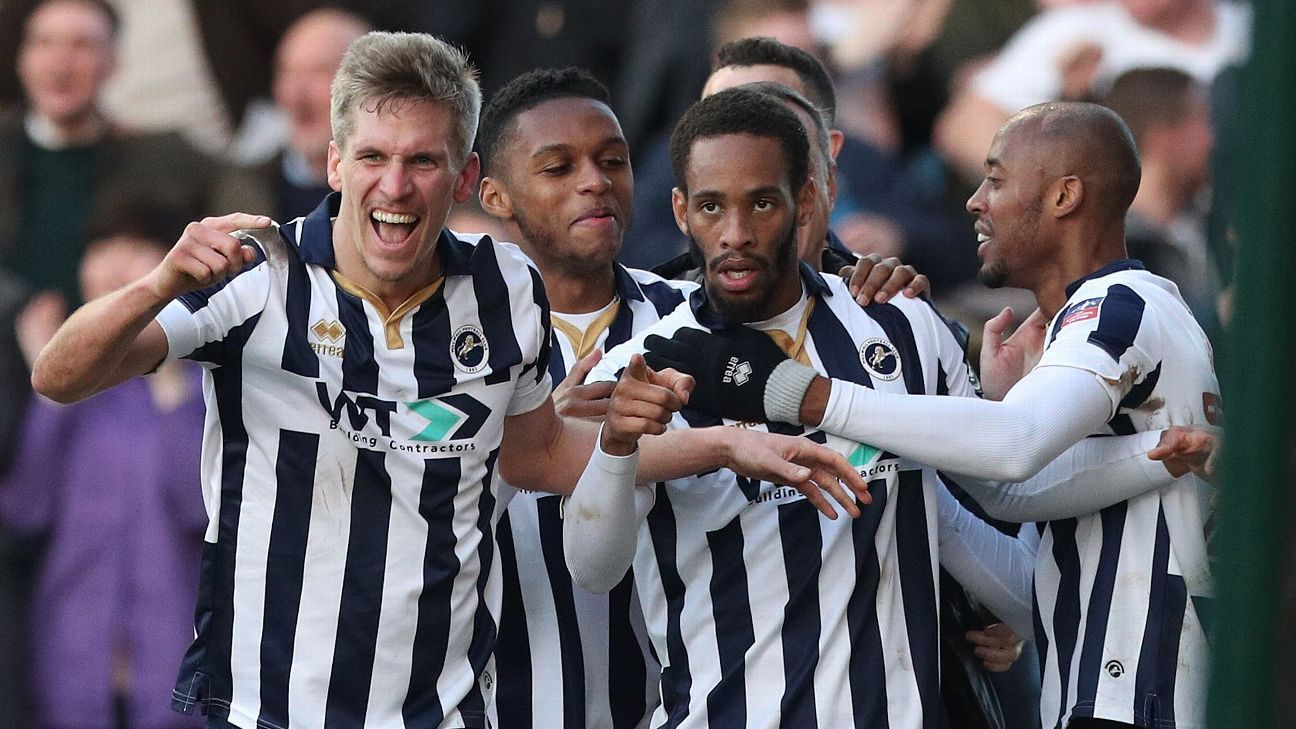 Millwall celebrate Shaun Cummings' winner.
