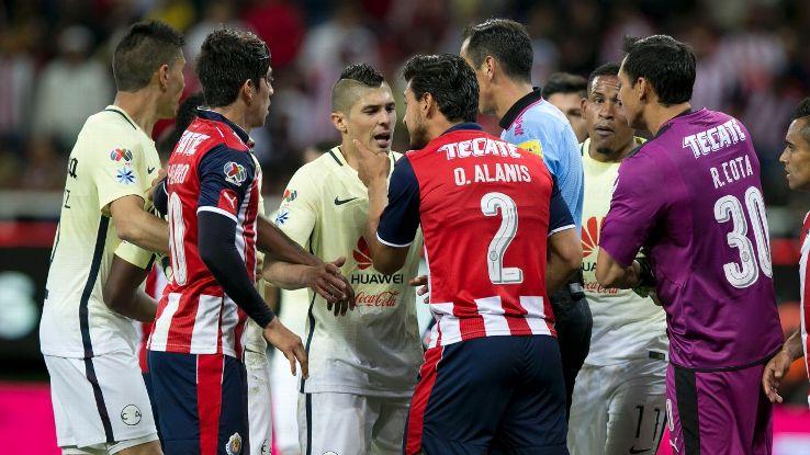 Chivas and America players argue during Saturday's Clasico Nacional.