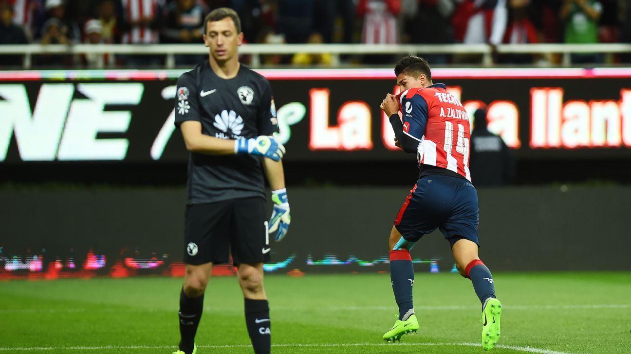 Chivas' Angel Zaldivar wheels away after scoring against America in Saturday's Clasico Nacional.