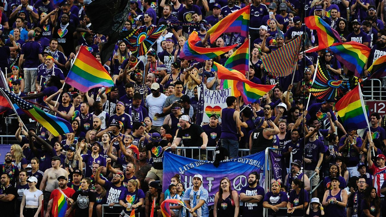Orlando City fans wave rainbow flags