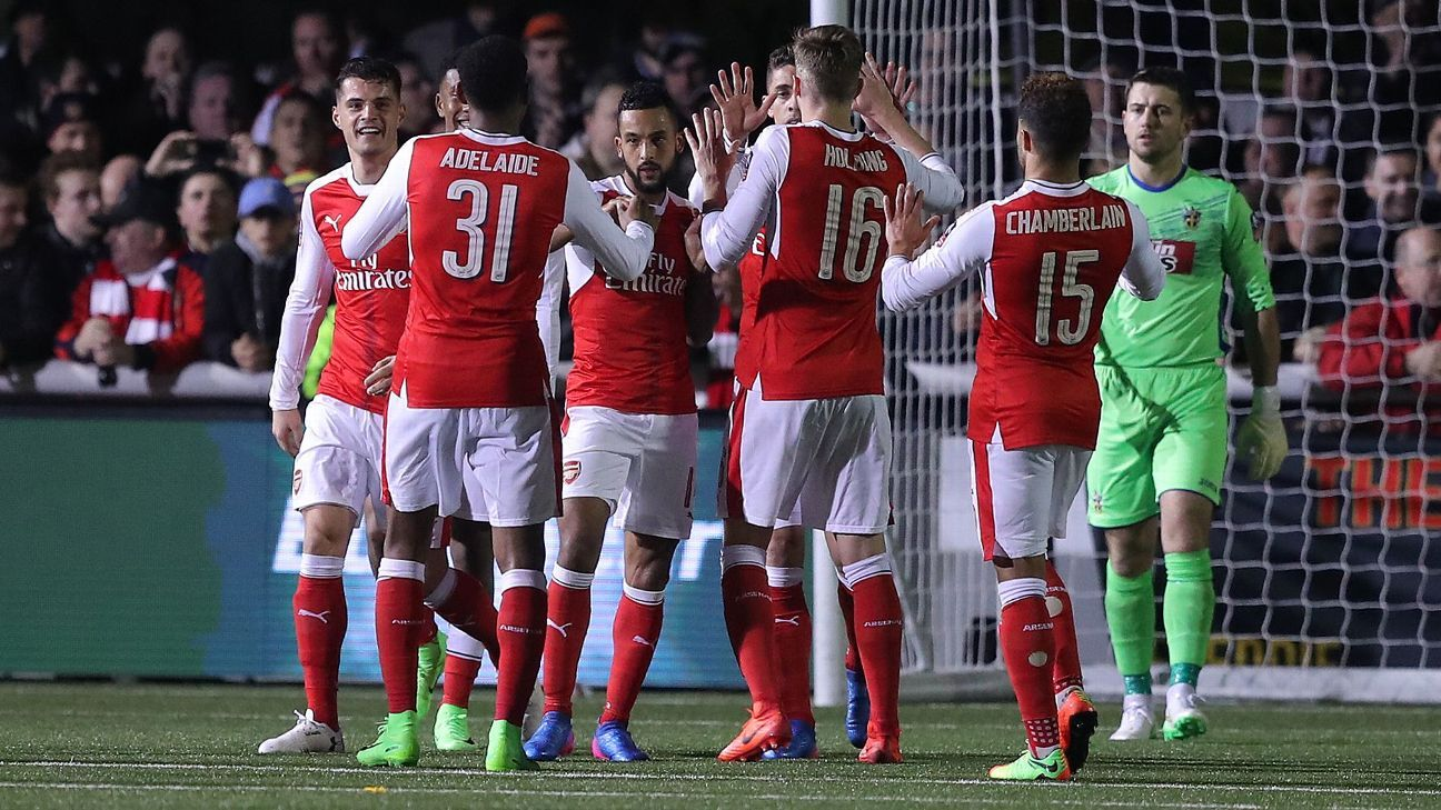 Arsenal make hard work of non-league Sutton but win in FA Cup fifth round