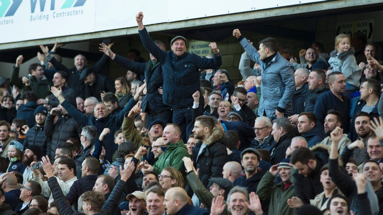 Millwall fans celebrate their FA Cup victory against Leicester City.