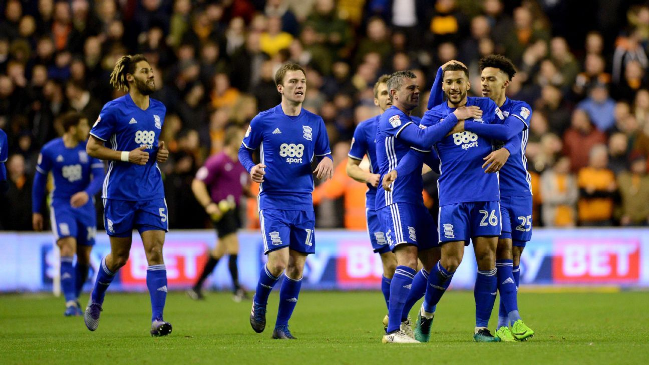 David Davies of Birmingham City celebrates with teammates after scoring a goal in their win against Wolves.