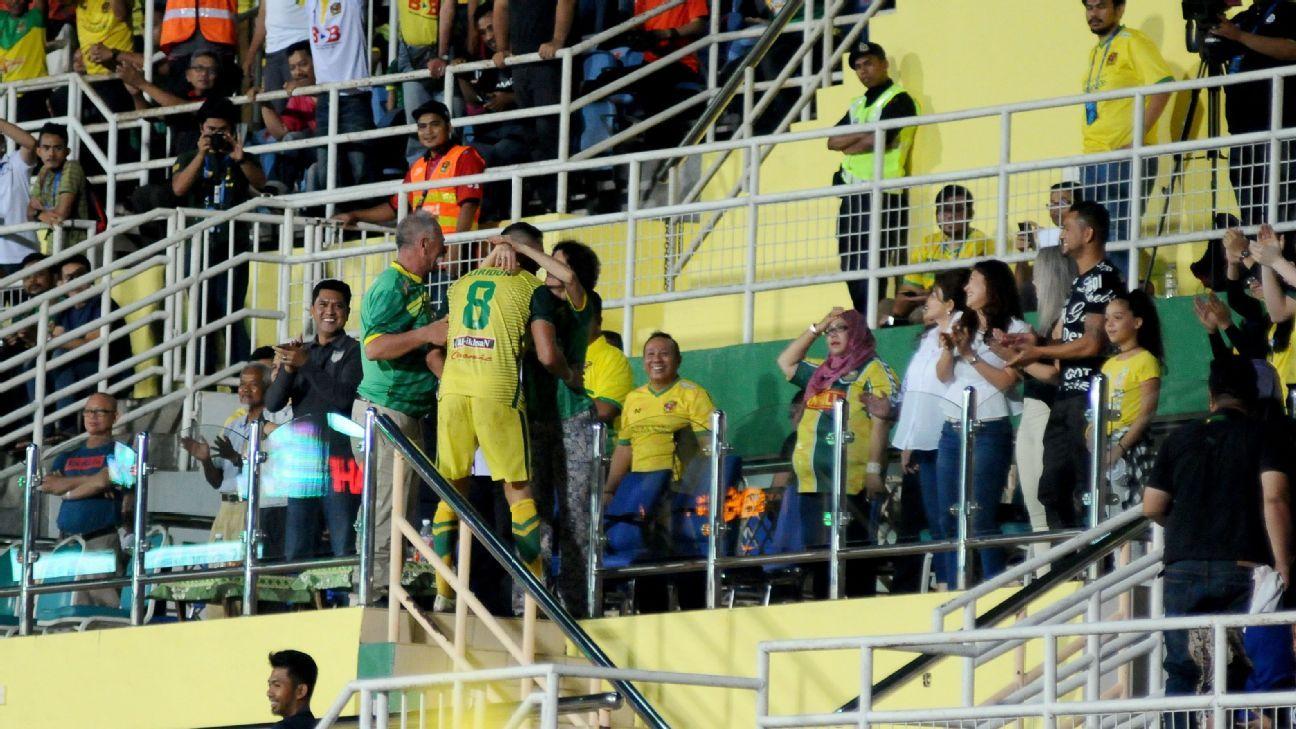 Liridon Krasniqi of Kedah celebrates with parents