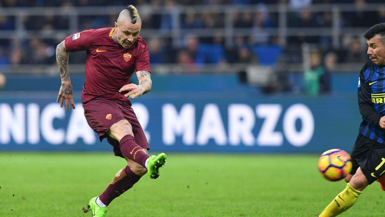 Radja Nainggolan scores a goal against Inter Milan in their Serie A match on Sunday.