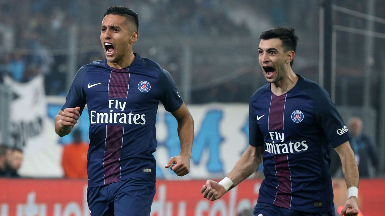 Marquinhos of PSG celebrates his goal with teammate Javier Pastore after scoring a goal in a win against Marseille.